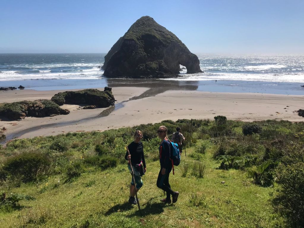 Hikers on Chiloe beach in Chile